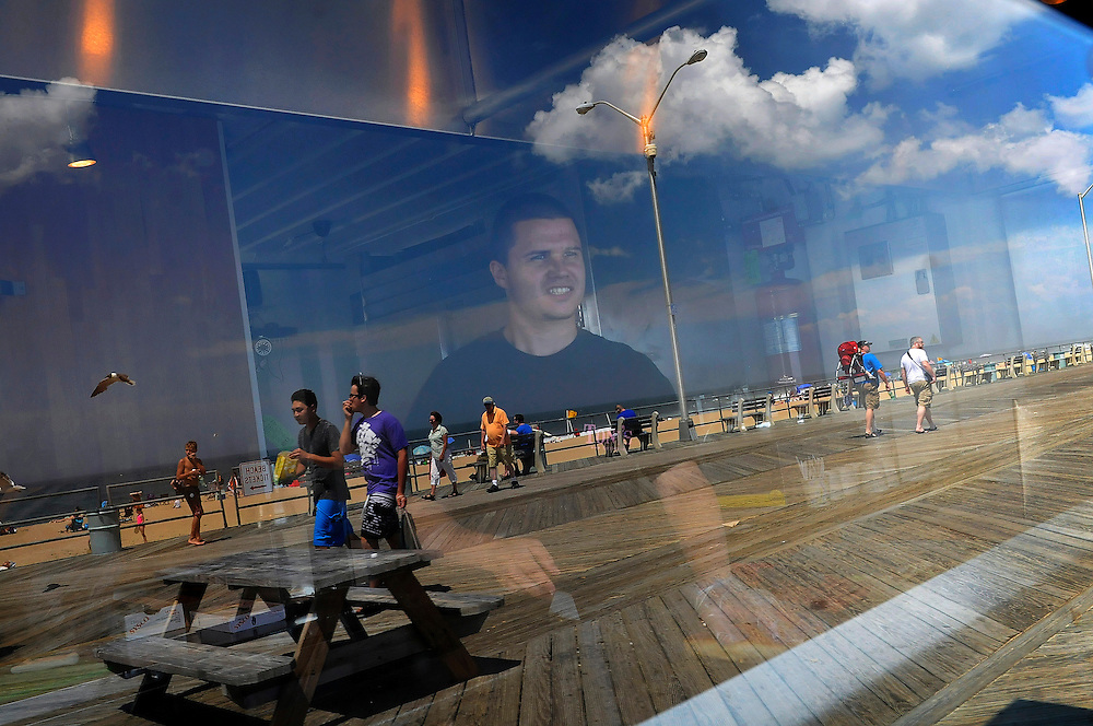 Sean Wilson mans the grill at Tony's Sausage, Dogs, and Cheese Steaks on the Asbury Park boardwalk on June 28. During the school year, Wilson studies food service management at Johnson and Wales University in Rhode Island.