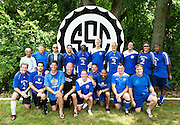 Men's amateur master soccer team photo.