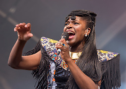 © Licensed to London News Pictures. 27/06/2019. Bristol, UK. IBIBIO SOUND MACHINE with lead singer ENO WILLIAMS in concert at the Bristol Sounds 2019 series of concerts at the Lloyds Amphitheatre on Bristol's Harbourside. Photo credit: Simon Chapman/LNP.