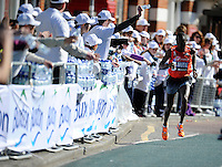 Geoffrey Mutai grabs a bottle of Buxton water<br /> The Virgin Money London Marathon 2014<br /> 13 April 2014<br /> Photo: Javier Garcia/Virgin Money London Marathon<br /> media@london-marathon.co.uk