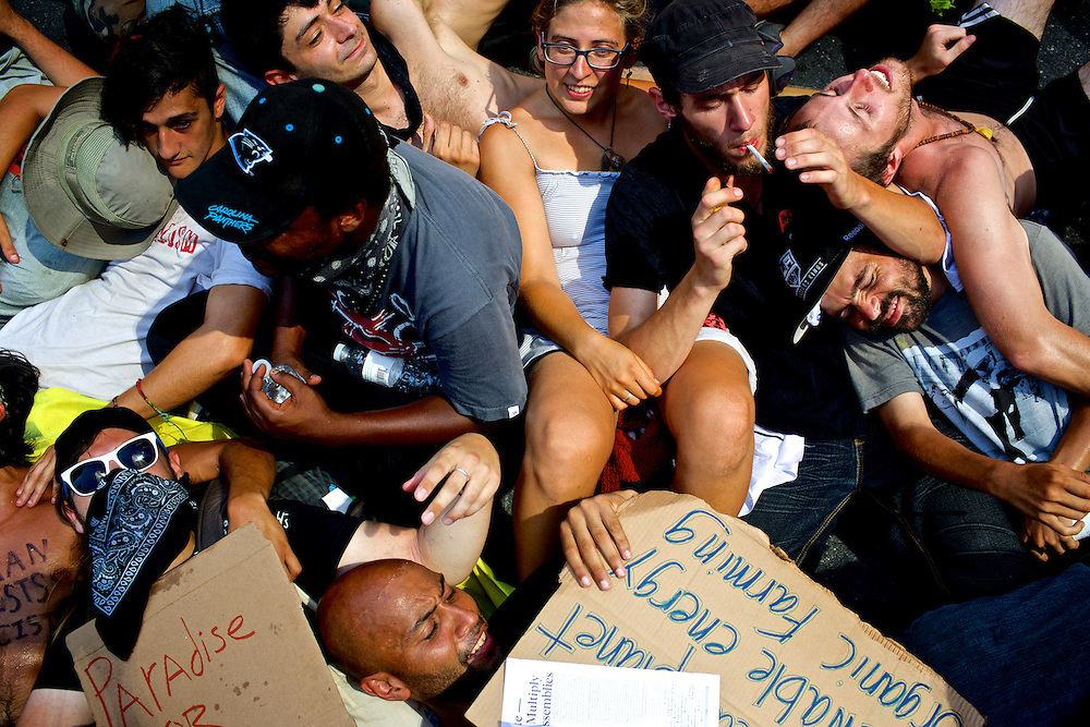 Members of the Occupy movement form a cuddle puddle while waiting for a protest march to continue two days before the 2012 Democratic National Convention in Charlotte, N.C. on Sept. 2, 2012.