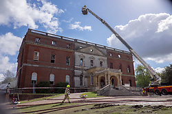 © Licensed to London News Pictures. 30/04/2015. Surrey, UK. Fire officer at the scene of the fire today 30 April 2015. A fire at the National Trust-run Clandon Park House, near Guildford, is thought to have started in the basement just after 16:00 BST on Wednesday. Photo credit : Stephen Simpson/LNP