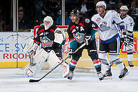 KELOWNA, CANADA - SEPTEMBER 28:  Jordon Cooke #30 and Madison Bowey #4 of the Kelowna Rockets defend the net against the Victoria Royals  at the Kelowna Rockets on September 28, 2013 at Prospera Place in Kelowna, British Columbia, Canada (Photo by Marissa Baecker/Shoot the Breeze) *** Local Caption ***