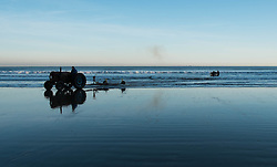 © Licensed to London News Pictures. 11/03/2014<br /> <br /> Saltburn by the Sea, England<br /> <br /> Local fishermen launch their boat from the beach at first light in Saltburn by the Sea in Cleveland.<br /> <br /> Photo credit : Ian Forsyth/LNP