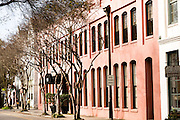 A pink building facade on Rainbow Row along East Bay Street in historic Charleston, SC.