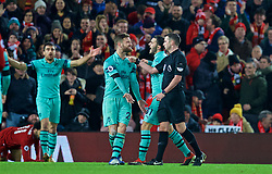 LIVERPOOL, ENGLAND - Saturday, December 29, 2018: Arsenal's Shkodran Mustafi and Sad Kolašinac argue with referee Michael Oliver after he awarded Liverpool a penalty during the FA Premier League match between Liverpool FC and Arsenal FC at Anfield. (Pic by David Rawcliffe/Propaganda)