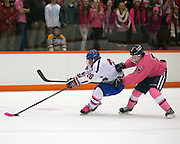 Erik Barkstrom of Pittsford pursues Alex Schoepfel of Fairport during a game at RIT on Saturday, January 24, 2015.