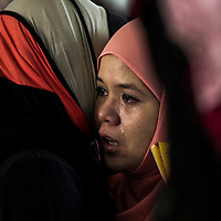 Friends of the crashed Malaysia Airlines MH 17 flight, Nur Shazana cries during a religious event to remember her at a mosque friend in Kuala Lumpur,  Malaysia, 19 July 2014. International observers were to mount another attempt 19 July to gain access to the crash site of a Malaysia Airlines passenger plane in eastern Ukraine, after being hindered by pro-Russian armed separatists.