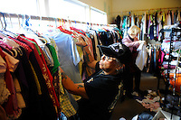 A volunteer sorts items for giveaway in the clothing room at the First United Methodist Church in Salinas, California. Members of the community drive a program that provides meals, counseling resources and occasional shelter to people in need. Basic rules, a generous spirit and a firm hand keep the program alive with minimal outside funding.