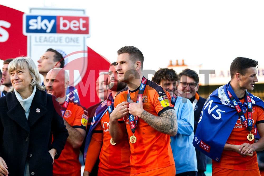 James Collins looks on as Luton Town celebrate winning the league and securing automatic promotion from Sky Bet League 1 to the Sky Bet Championship - Rogan/JMP - 04/05/2019 - Kenilworth Road - Luton, England - Luton Town v Oxford United - Sky Bet League One.