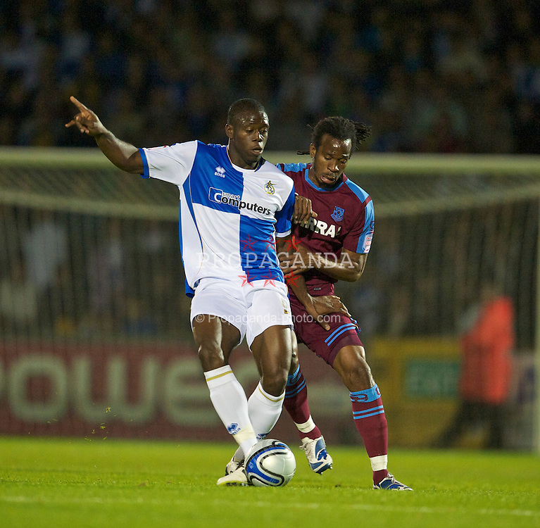 BRISTOL, ENGLAND - Tuesday, September 28, 2010: Tranmere Rovers' Ian Goodison and Bristol Rovers' John Akinde during the Football League One match at the Memorial Ground. (Photo by David Rawcliffe/Propaganda)