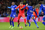 Liverpool forward Roberto Firmino (11) battles with Leicester City Daniel Amartey (13) and Leicester City midfielder Wilfred Ndidi (25) during the Premier League match between Leicester City and Liverpool at the King Power Stadium, Leicester, England on 27 February 2017. Photo by Jon Hobley.