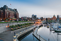 Buildings glow as twilight settles in on downtown Victoria, BC Canada.