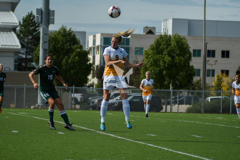 3rd year midfielder Nikita Senko (9) of the Regina Cougars  heads the ball during the Women's Soccer Homeopener on September 10 at U of R Field. Credit: Arthur Ward/Arthur Images