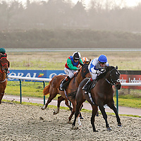 Rebellious Guest and Jamie Spencer winning the 2.35 race