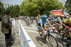 Peloton speed by at Tour of Chongming Island - Stage 3. A 111.6km road race on Chongming Island, China on 7th May 2017.