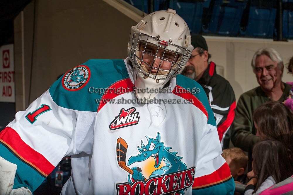 KELOWNA, CANADA - DECEMBER 27: Jackson Whistle #1 of the Kelowna Rockets walks to the ice for warm up against the Kamloops Blazers on December 27, 2013 at Prospera Place in Kelowna, British Columbia, Canada.   (Photo by Marissa Baecker/Shoot the Breeze)  ***  Local Caption  ***