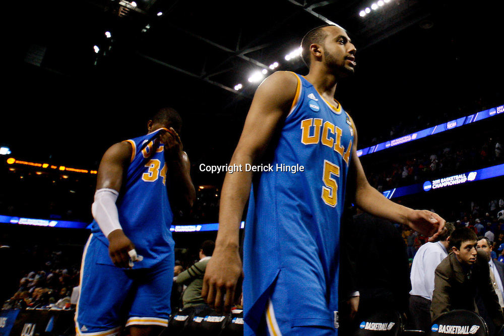 Mar 19, 2011; Tampa, FL, USA; UCLA Bruins players UCLA Bruins guard Jerime Anderson (5) and center Joshua Smith (34) walk off the court following a loss to the Florida Gatorsin the third round of the 2011 NCAA men's basketball tournament at the St. Pete Times Forum. Florida defeated UCLA 73-65.  Mandatory Credit: Derick E. Hingle