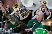 """Terry Knause and other members of the Ohio Alumni Varsity Band perform for Ohio Univeristy alumni and their families during a barbecue on the College Green on May 31, 2014. The event was part of the """"On The Green"""" weekend, hosted by the Ohio University Alumni Association. Photo by Lauren Pond"""
