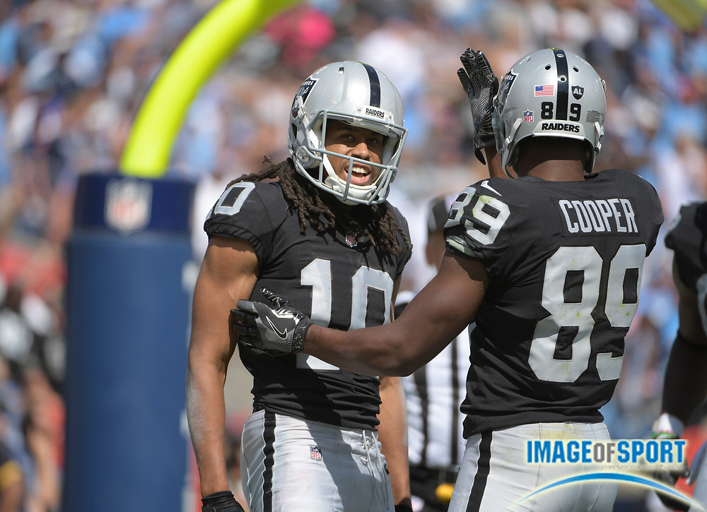 Sep 10, 2017; Nashville, TN, USA; Oakland Raiders wide receiver Seth Roberts (10) celebrates with receiver Amari Cooper (89) after scoring on a 19-yard touchdown reception in the fourth quarter against the Tennessee Titans during a NFL football game at Nissan Stadium. The Raiders defeated the Titans 26-16.