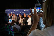 A member of the media takes a photo as Sacramento Mayor and President of the United States Conference of Mayors, Kevin Johnson, speaks during a press conference to begin 82nd annual meeting at the Omni Hotel in Dallas, Texas on June 20, 2014.  (Cooper Neill for The New York Times)