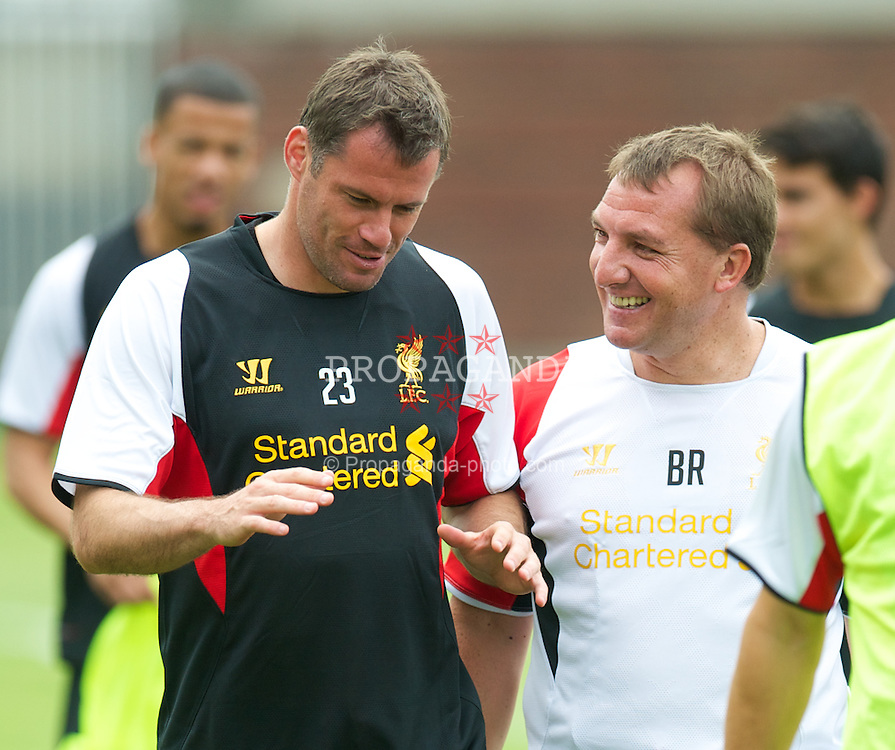 BOSTON, MA - Monday, July 23, 2012: Liverpool's Jamie Carragher and manager Brendan Rodgers during a training session at the Harvard Stadium fields ahead of the pre-season match against AS Roma during the club's North American pre-season tour. (Pic by David Rawcliffe/Propaganda)