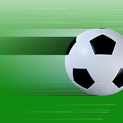 Soccer ball on a green background with blur to depict motion and light streaks.
