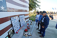 Families remember during a Veterans Day ceremony on Wednesday at the Monterey County Vietnam Veterans Memorial in Salinas.