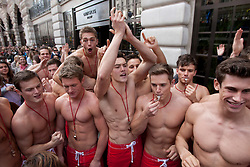 © licensed to London News Pictures. London, UK 12/05/2012. 100 Lifeguards gathering as they promote opening of the new Gilly Hicks and Hollister Flagship Stores on Regent Street, this morning (12/05/12). Photo credit: Tolga Akmen/LNP