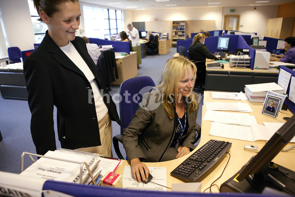 Work colleagues working in the offices at NHS Octavia House,