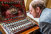 Royal Academician Richard Wilson examines Queen Victoria's paintbox. Achitect, Sir David Chipperfield unveils plans for a major redevelopment of the Royal Academy of Arts which will be completed in time for its 250th anniversary in 2018. The project is the most important development of the Royal Academy in its history.  The development will allow key works from the Royal Academy's Collection to be brought out of store and go on view to the public. These include Queen Victoria's paintbox, Turner's travelling watercolour box, Joshua Reynolds' diaries, a rarely displayed Pissarro drawing, and letters between artists such as Thomas Gainsborough to Sir Joshua Reynolds. 11 May 2015.