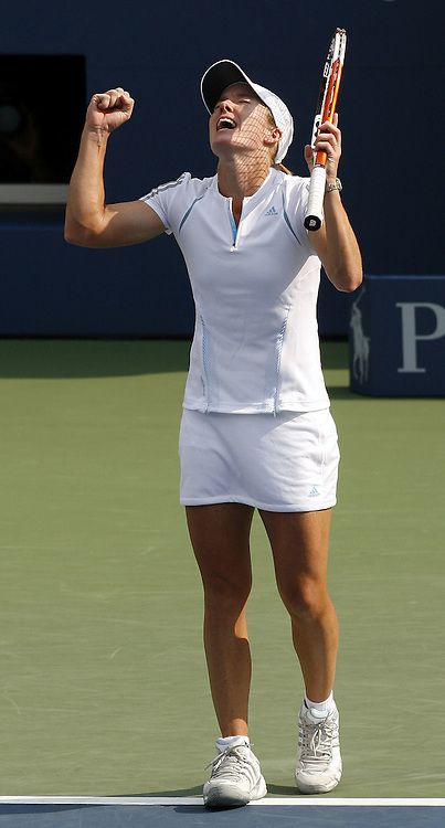 Justine Henin-Hardenne of Belgium reacts after defeating Jelena Jankovic of Serbia and Montenegro during their semifinal match on the twelveth day of the 2006 US Open tennis tournament in Flushing Meadows, New York Friday, 08 September 2006.