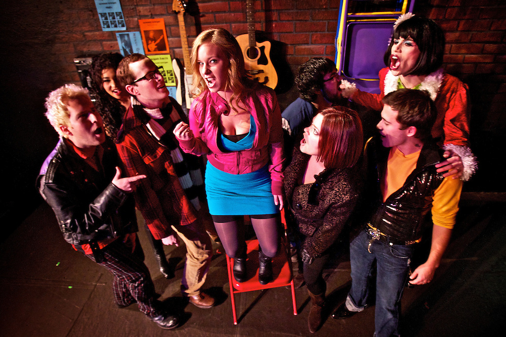 "Nadine Carr belts out a tune from the Lake City Playhouse Production of ""Rent"" while surrounded by her co-stars, from left, Robby French, Keyonna Knight, Todd Kehne, Ben Scheff, Christina Coty, Robert Garcia and Dustin Sorell. The musical opens tonight and runs through Jan. 29."
