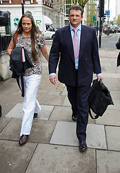 © Licensed to London News Pictures. 08/05/2013 London, UK.  John Hardy, 43, and  wife Claire arrive at Westminster Magistrates Court. Hardy, who served as a Colour Sergeant at the Royal Military Training Academy at Sandhurst, and his 39-year-old wife are alleged to have been paid £23,000 for stories relating to the Royal Family by Sun Royal correspondent Duncan Larcombe..Photo credit : Simon Jacobs/LNP
