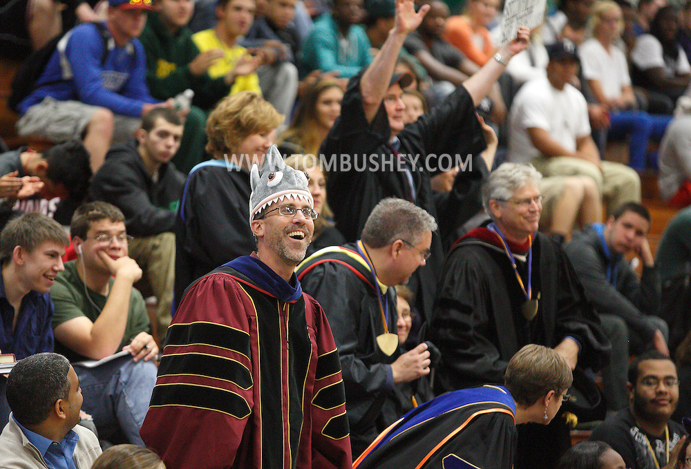 SUNY Sullivan liberal arts department chairman Paul Reifenheiser, at left, and other members of his department stand as they are introduced during the convocation at the college in Loch Sheldrake on Monday, Sept. 9, 2013.
