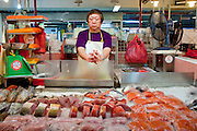 "Apr. 28 -- SINGAPORE:  A fish monger in the ""wet"" market in Chinatown in Singapore.   PHOTO BY JACK KURTZ"