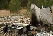 Hot spring hosed into old claw tub. Atlanta, Idaho.