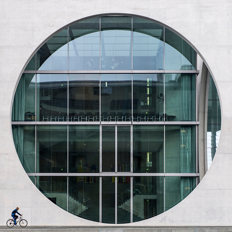 A cyclist beside the new Federal Chancellery in Berlin.