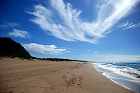 View along Barking sands showing wispy clouds in a blue sky