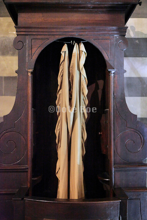 close up of a confessional with curtain open Italy