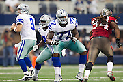 DALLAS, TX - SEPTEMBER 23:  Tyron Smith #77 of the Dallas Cowboys blocks during a game against the Tampa Bay Buccaneers at Cowboys Stadium on September 23, 2012 in Dallas, Texas.  The Cowboys defeated the Buccaneers 16-10.  (Photo by Wesley Hitt/Getty Images) *** Local Caption *** Tyron Smith