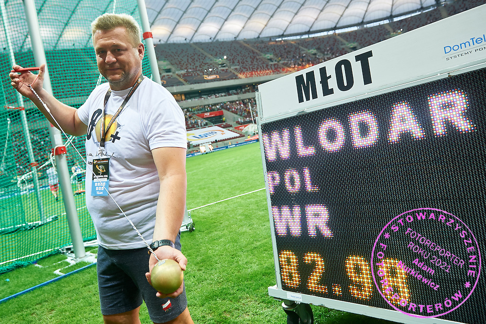 Warsaw, Poland - 2016 August 28: Poland's coach Krzysztof Kaliszewski pose with a hammer and  world record in the women's hammer throw competition with the result 82.98m during athletics meeting Kamila Skolimowska Memorial 2016 at PGE National Stadium  August 28, 2016 w Warsaw, Poland.<br /> <br /> Adam Nurkiewicz declares that he has no rights to the image of people at the photographs of his authorship.<br /> <br /> Picture also available in RAW (NEF) or TIFF format on special request.<br /> <br /> Any editorial, commercial or promotional use requires written permission from the author of image.<br /> <br /> Mandatory credit:<br /> Photo by &copy; Adam Nurkiewicz