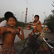 Young boys play outside the coal-powered electricty plant in Phai Lai, about 70 kilometers east of Hanoi, Vietnam, 14 September, 2007.