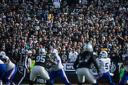 Oakland Raiders fans watch as the Oakland Raiders defense works against the Buffalo Bills in the first quarter at Oakland Coliseum in Oakland, Calif., on December 4, 2016. (Stan Olszewski/Special to S.F. Examiner)