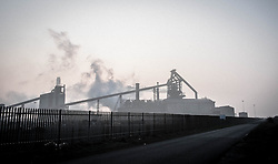 © Licensed to London News Pictures. <br /> 18/03/2015. <br /> <br /> Redcar, Teesside.<br /> <br /> The Steel works is shrouded as fog and mist descends on an area known as South Gare near Redcar on Teesside.<br /> <br /> Photo credit : Ian Forsyth/LNP