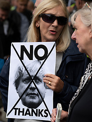 Edinburgh, Scotland, UK. 29 July 2019. Prime Minister Boris Johnson meets Scotland's First Minister Nicola Sturgeon at Bute House in Edinburgh on his visit to Scotland. Pictured. Protestors hold anti Boris Johnson sign.