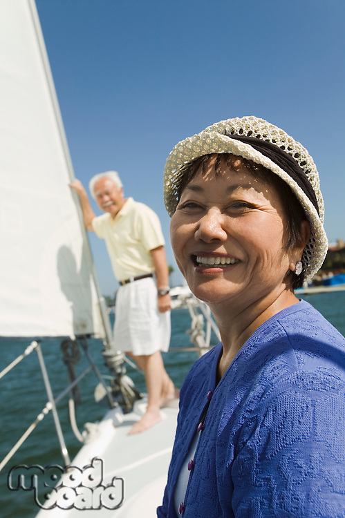 Smiling Woman and Husband on Sailboat