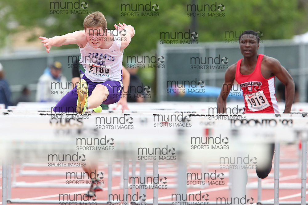 Ryan Harper of Thousand Islands SS - Brockvil competes in the sprint hurdle heats at the 2013 OFSAA Track and Field Championship in Oshawa Ontario, Thursday,  June 6, 2013.<br /> Mundo Sport Images / Sean Burges