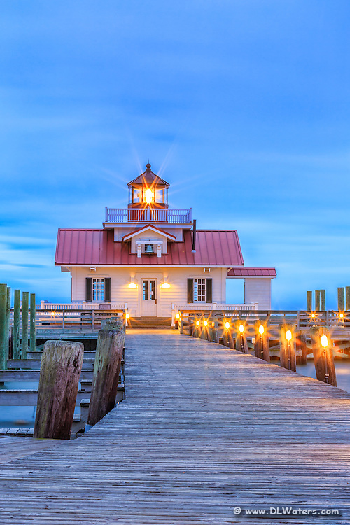 Roanoke Marshes Lighthouse at twilight. A aperture of F/18 turns each of the lights into starbursts.