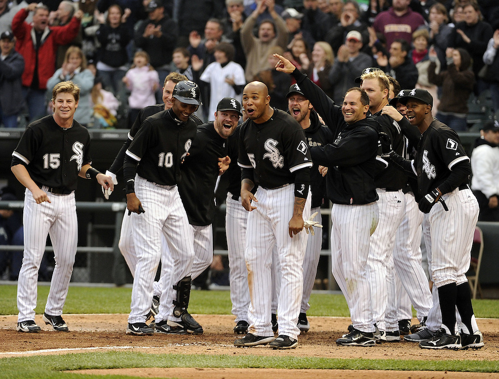 CHICAGO - APRIL 24:  The White Sox, led by Andruw Jones #25, gather at home plate to greet Alex Rios #51 of the Chicago White Sox after Rios hit a walk-off, two-run home run against David Aardsma #53 of the Seattle Mariners on April 24, 2010 at U.S. Cellular Field in Chicago, Illinois.  Jones hit a walk-off home run the night before.  The White Sox defeated the Mariners 5-4.  (Photo by Ron Vesely)